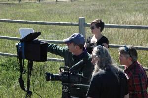 Director Jeff Kingery, Gaffer Samantha Randel, Director of Photography Ken Hendricks and Assistant Director Matthew Mertens prepare to shoot a scene in Table 47.